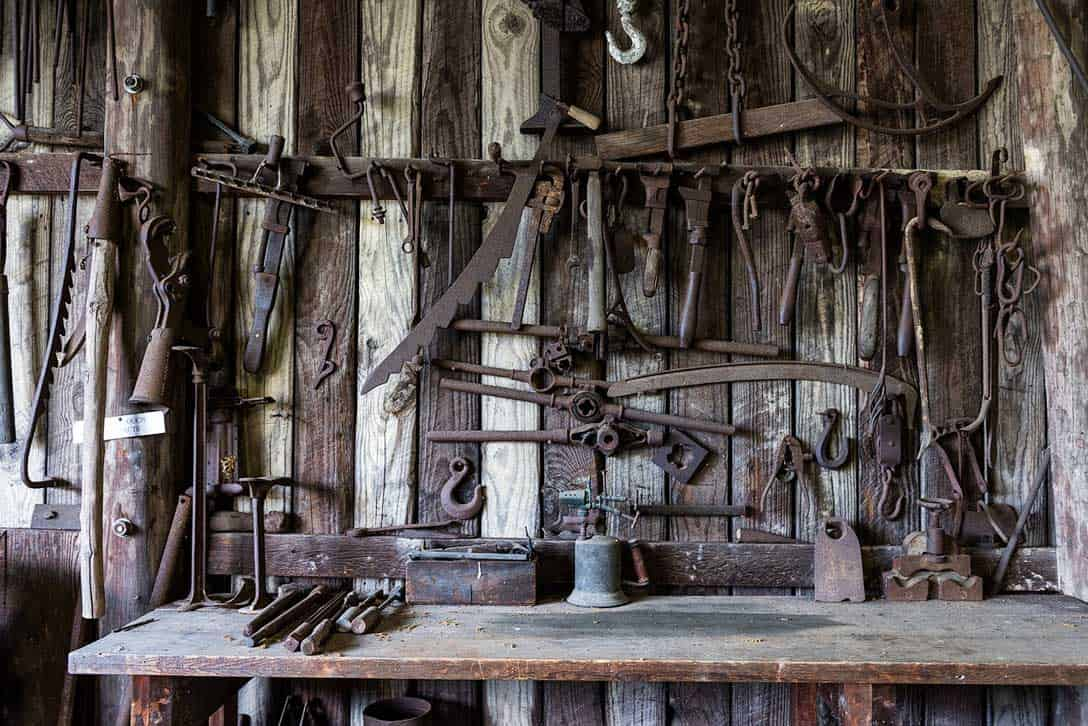 workbench with rusted tools